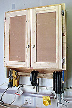 The small size of this cabinet is perfect for behind a bench. Click image to enlarge & Shop Wall Cabinet with Clamp Storage - NewWoodworker.com LLC