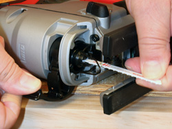 Milwaukee m18 cordless jig saw kit newwoodworker llc changing blades takes no more than a finger to flip the locking lever open left to install a new blade flip the lever open put the blade in the shaft greentooth